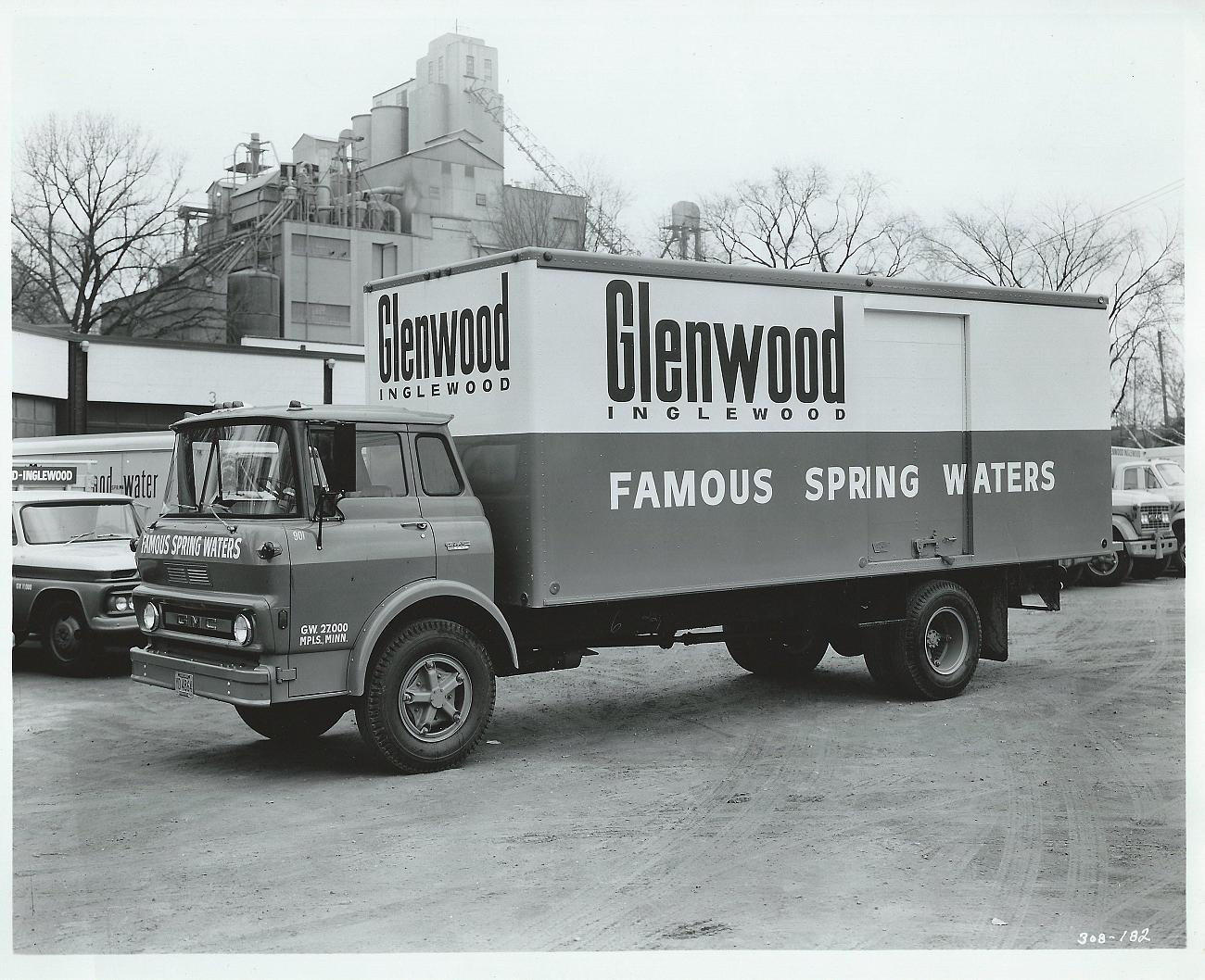 A Glenwood Water truck fron the early 1960's with a functional Fruen Mill in the background.